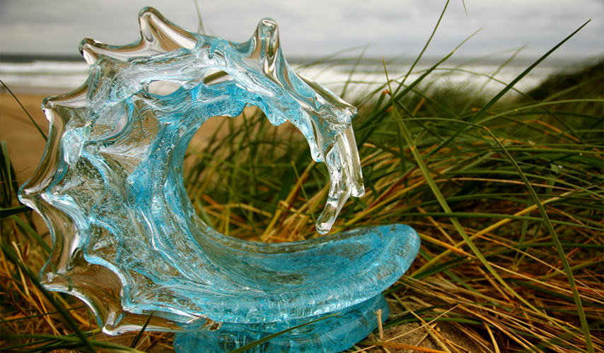 Champagne Glass Wave Sculpture on the Beach - David Wight Glass Art
