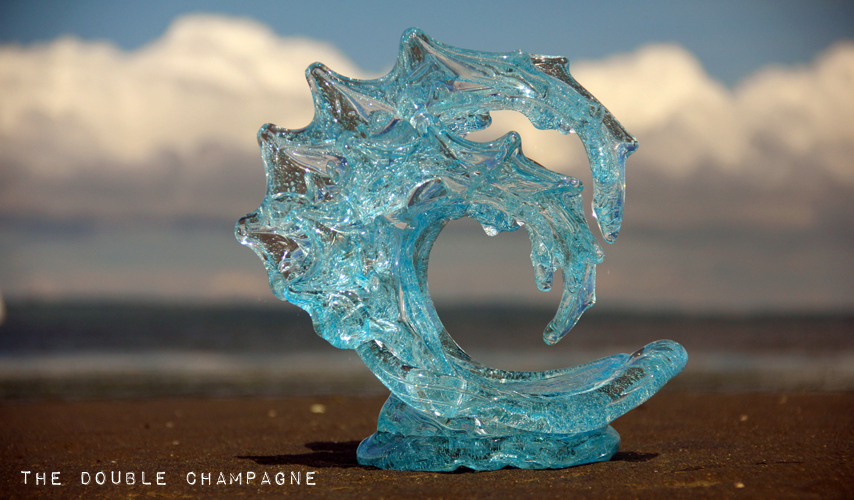 Double Champagne Glass Wave Sculpture on the Beach - David Wight Glass Art