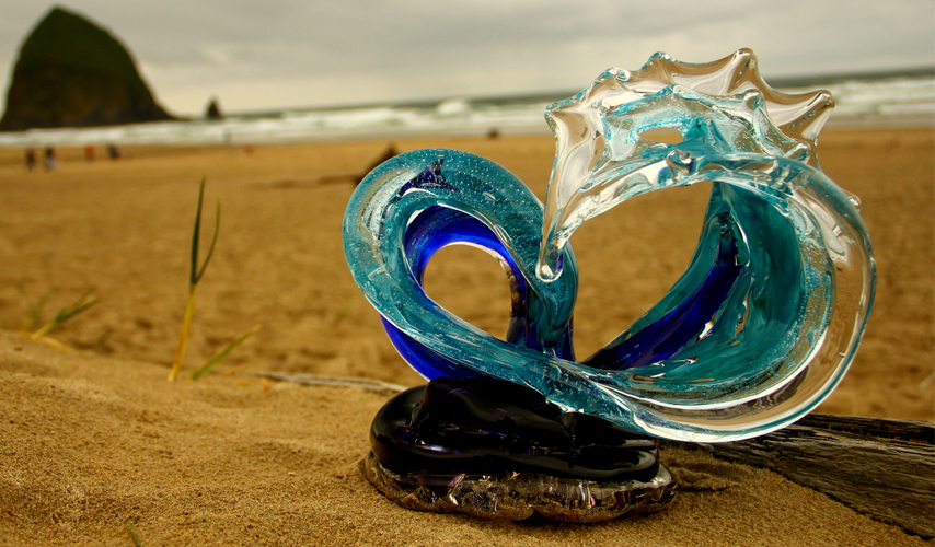 Neptune Glass Wave Sculpture on the Beach - David Wight Glass Art