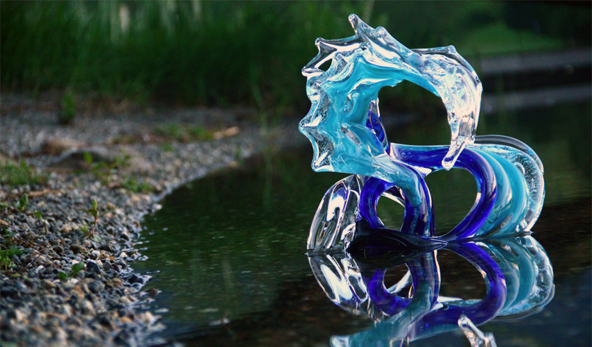 Neptune Glass Wave Sculpture in the water - David Wight Glass Art