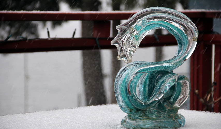 Neptune Glass Wave Sculpture in the snow - David Wight Glass Art