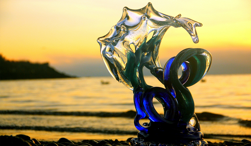 Neptune Glass Wave Sculpture at sunset - David Wight Glass Art