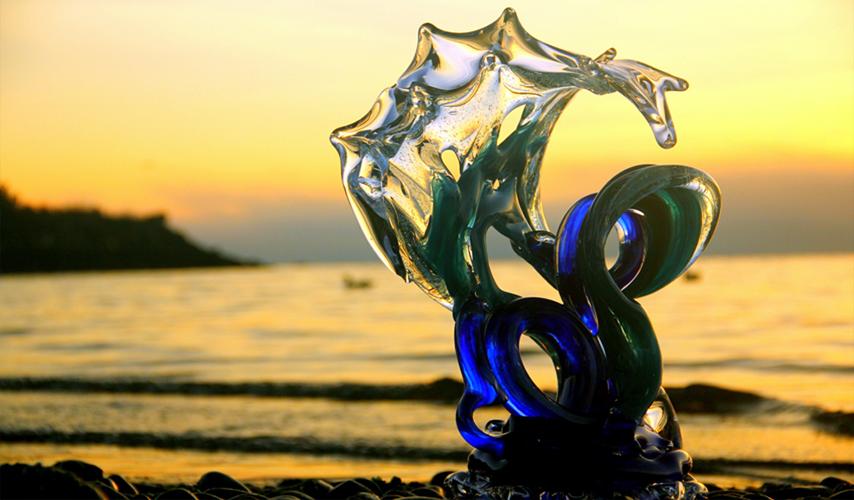 Neptune Glass Wave Sculpture at sunset - David Wight Glass Art